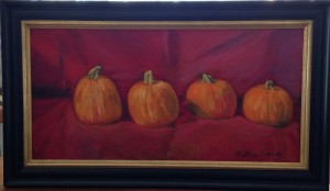 Pumpkins on red velvet cloth